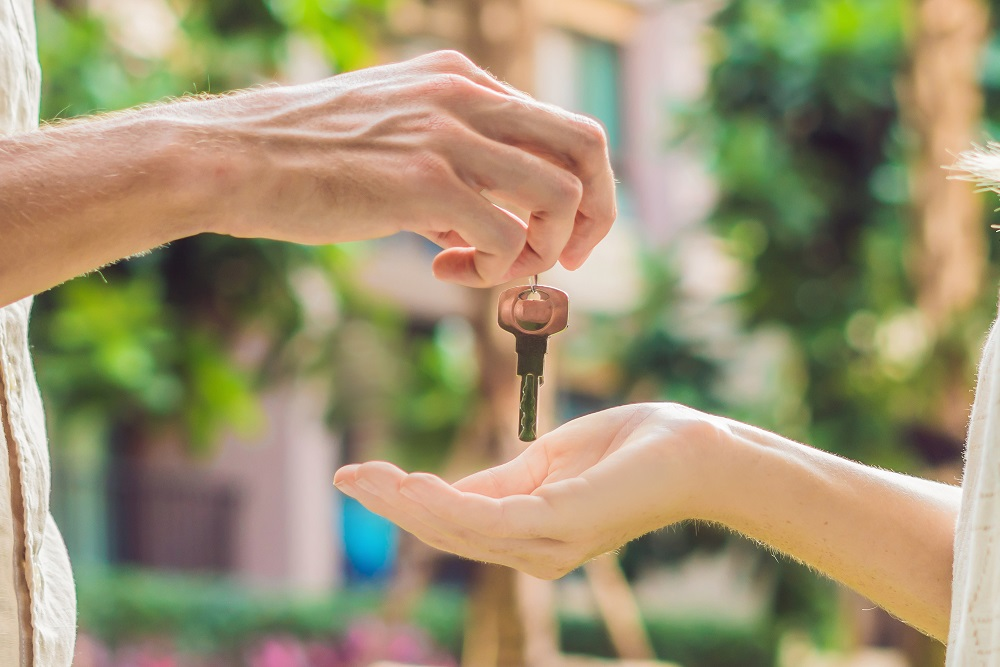 Old property owner is giving keys to new property owner