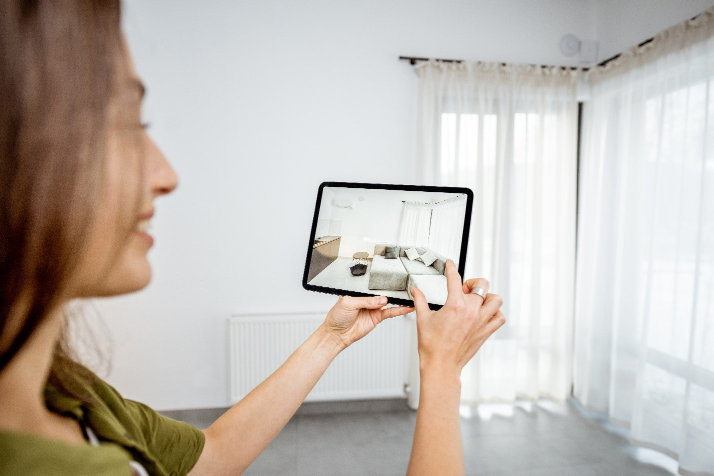 A Women Checking A Property On Her Tablet